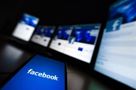 The loading screen of the Facebook application on a mobile phone is seen in this photo illustration taken in Lavigny May 16, 2012. REUTERS/V