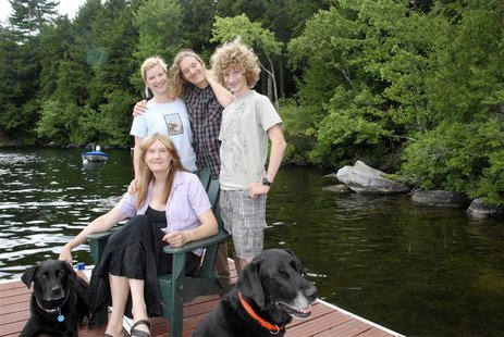 "Writer Jennifer Finney Boylan, author of the book ""Stuck in the Middle with You,"" sits with her spouse Deidre and their sons Zach and Sean ("
