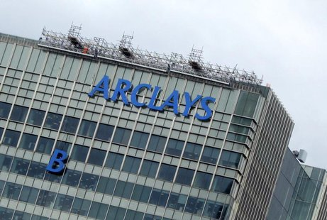 "The letter ""B"" of the signage on the Barclays headquarters in Canary Wharf is hoisted up the side of the building in London July 20, 2012. R"