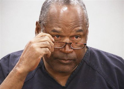 O.J. Simpson takes his glasses off during his evidentiary hearing testimony in Clark County District Court in Las Vegas, Nevada in this May
