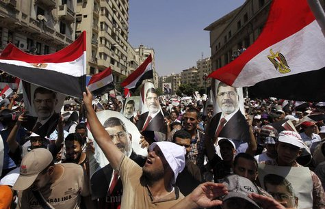 Members of the Muslim Brotherhood and supporters of ousted Egyptian President Mohamed Mursi shout slogans and close the roads during a prote