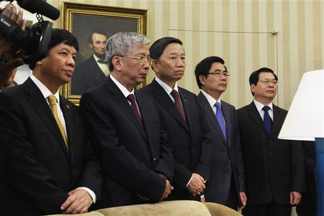 Members of the Vietnamese delegation stand during a meeting between Vietnam's President Troung Tan Sang and U.S. President Barack Obama (bot