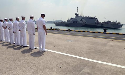 U.S. Navy sailors look at the littoral combat ship USS Freedom as it arrives in Changi Naval Base in this April 18, 2013 photo provided by t