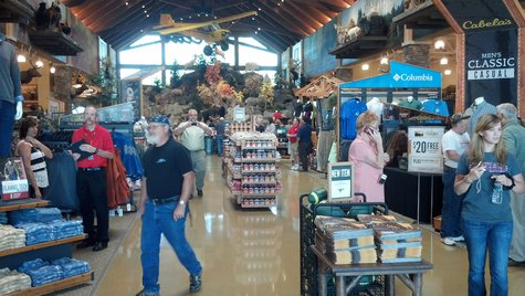 Customers walk around inside the new Cabela's store in Ashwaubenon on July 25, 2013. (Photo by: Jeff Flynt).