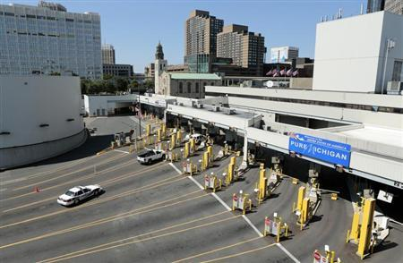 Police vehicles are pictured at empty customs lanes entering the U.S. at the Detroit-Windsor Tunnel in Detroit, Michigan on July 12, 2012. Credit: Reuters/Jeff Kowalsky