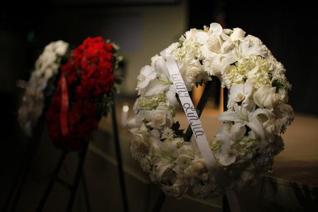 Wreaths are seen at a prayer vigil for the victims of the Asiana Airlines crash at West Valley Christian School in West Hills, Los Angeles,