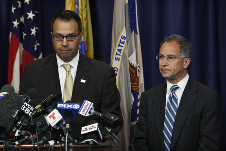 U.S. Secret Service Special Agent James Mottola (L ) and New Jersey Attorney Paul J. Fishman speak to the media during a news conference in