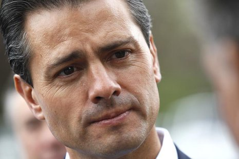 Mexican President Enrique Pena Nieto listens to an attendee at the annual Allen and Co. conference at the Sun Valley, Idaho Resort July 11,
