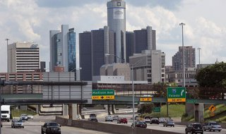 Vehicles enter and exit the downtown on the freeway, in front of General Motors World Headquarters in downtown Detroit, Michigan July 20, 20