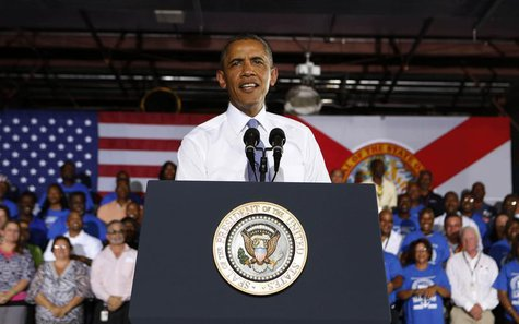 U.S. President Barack Obama speaks about the U.S. economy inside the main warehouse at the Jacksonville Port in Florida, July 25, 2013. REUT