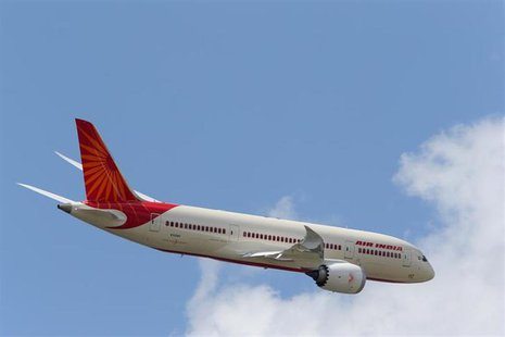 An Air India Airlines Boeing 787 dreamliner takes part in a flying display during the 50th Paris Air Show at the Le Bourget airport near Par