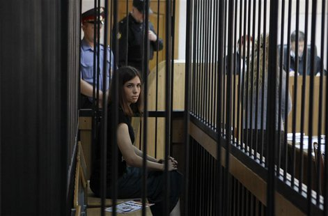 "A member of the female punk band ""Pussy Riot"", Nadezhda Tolokonnikova, looks out from a holding cell as she attends a court hearing to appea"