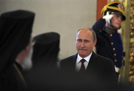 Russian President Vladimir Putin arrives for a meeting with Russian Orthodox church officials in Moscow's Kremlin July 25, 2013. REUTERS/Ale