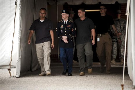Private First Class Bradley Manning (C), 25, is escorted out of court after closing arguments in his military trial at Fort Meade, Maryland