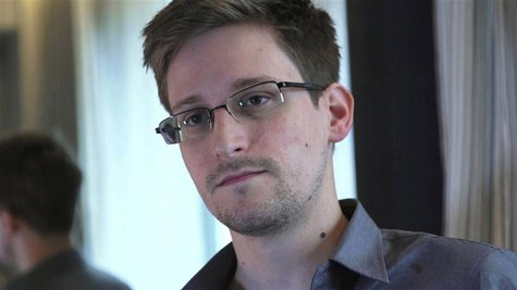 Former U.S. spy agency contractor Edward Snowden is seen in this still image taken from video during an interview by The Guardian in his hot