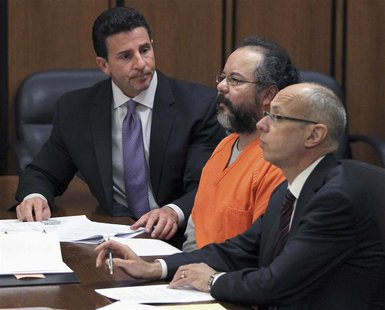 Ariel Castro (C), 53, listens to the judge as he sits between his attorneys Jaye Schlachet (R) and Craig Weintraub in the courtroom in Cleve