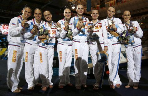 Russia's team show their gold medals after winning the synchronized swimming team free final during the World Swimming Championships at the