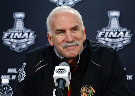 Chicago Blackhawks head coach Joel Quenneville listens to a question from a reporter in Chicago, Illinois, June 21, 2013. REUTERS/Jeff Hayne