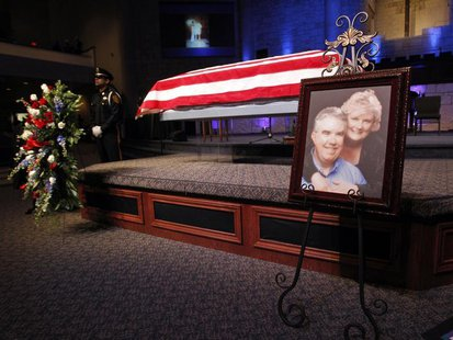 A photograph is displayed at a memorial service for Kaufman County district attorney Mike McLelland and his wife Cynthia in Sunnyvale, Texas