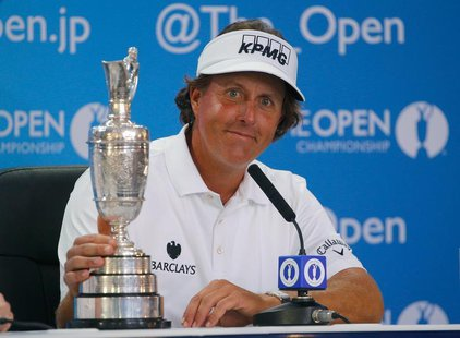 Phil Mickelson of the U.S. sits with the Claret Jug at a press conference after winning the British Open golf championship at Muirfield in S