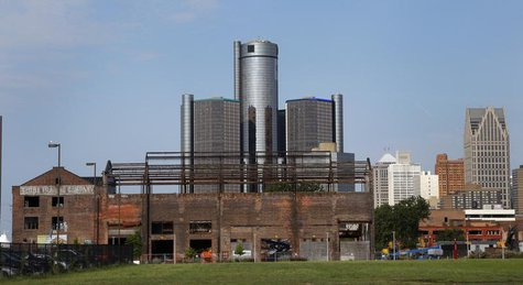 General Motors World Headquarters is seen behind a historic warehouse being restored along the Detroit River in Detroit, Michigan July 21, 2