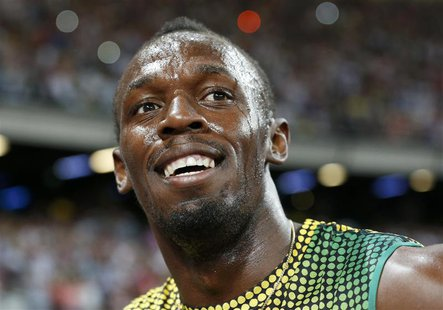 Usain Bolt of Jamaica smiles after winning the men's 100m event at the London Diamond League 'Anniversary Games' athletics meeting at the Ol