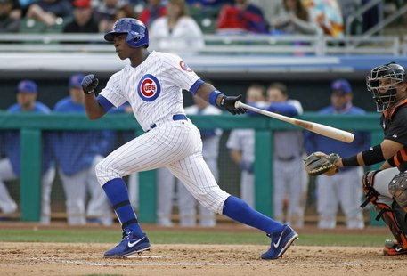 Chicago Cubs' Alfonso Soriano lines a single to the outfield against the San Francisco Giants during their MLB Cactus League spring training
