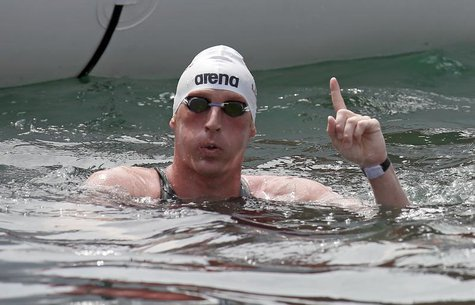 Thomas Peter Lurz of Germany celebrates as he won the men's 25km open water race during the World Swimming Championships at De La Fusta venu