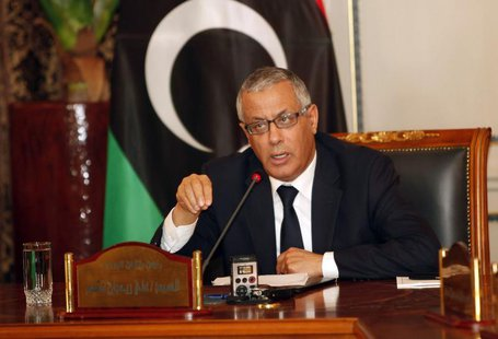 Libya's Prime Minister Ali Zeidan (C) speaks during a joint news conference at the headquarters of the Prime Minister's Office in Tripoli Ma