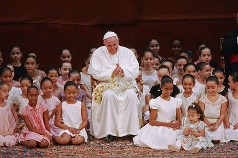 Pope Francis meets with children during an encounter with representatives of the civil society in the Municipal Theater in Rio de Janeiro, J