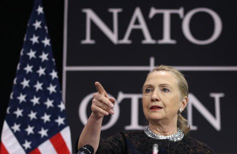 U.S. Secretary of State Hillary Clinton gestures as she addresses a news conference during a NATO foreign ministers meeting at the Alliance