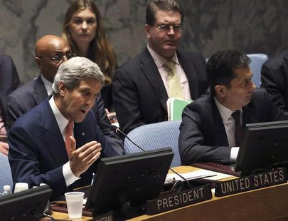 U.S. Secretary of State John Kerry (L) addresses the United Nations Security Council at the United Nations Headquarters in New York, July 25