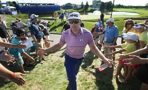 Hunter Mahan of the U.S. greets fans as he walks off the eighteenth green at the Canadian Open golf tournament at the Glen Abbey Golf Club i