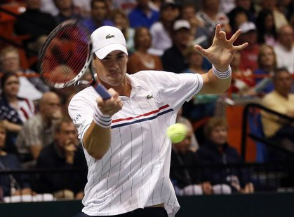 John Isner of the U.S. hits a return to Serbia's Novak Djokovic during their Davis Cup quarter-final tennis match in Boise, Idaho April 5, 2
