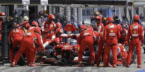 Ferrari Formula One driver Fernando Alonso of Spain makes a pitstop during the Hungarian F1 Grand Prix at the Hungaroring circuit in Mogyoro