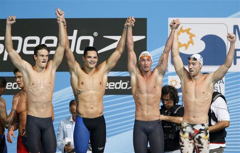 France's Yannick Agnel (L), Florent Manaudou (2nd L), Fabien Gilot (2nd R) and Jeremy Stravius celebrate after winning men's 4x100m freestyl