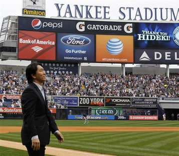 New York Yankees Hideki Matsui walks onto the field before their MLB American League game with the Tampa Bay Rays at Yankee Stadium in New Y