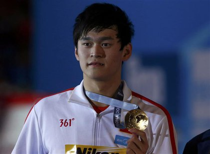 China's Sun Yang poses with his gold medal after winning the men's 400m freestyle final during the World Swimming Championships at the Sant