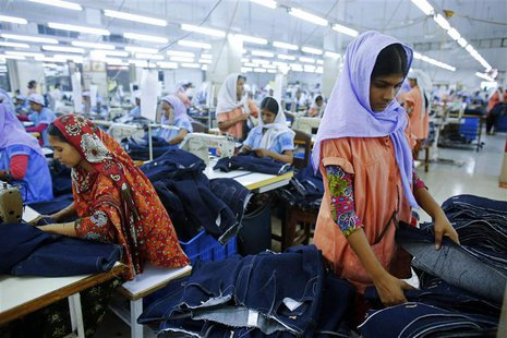 Workers sort clothes at a garment factory near the collapsed Rana Plaza building in Savar, Bangladesh June 16, 2013. REUTERS/Andrew Biraj