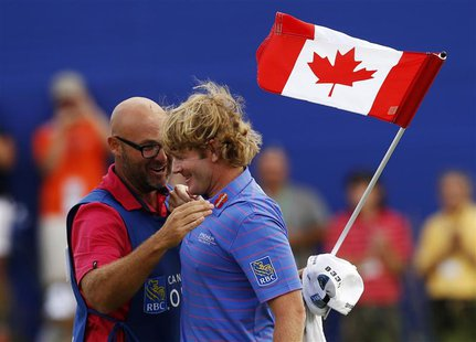 Brandt Snedeker of the U.S. celebrates with his caddy Scott Vail (L) of Canada after winning during the final round at the Canadian Open gol