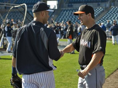 Florida Marlins hitting coach Tino Martinez (R) talks with New York Yankees shortstop Derek Jeter (L) before a MLB spring training baseball