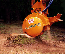 Tree Stump grinder on backhoe