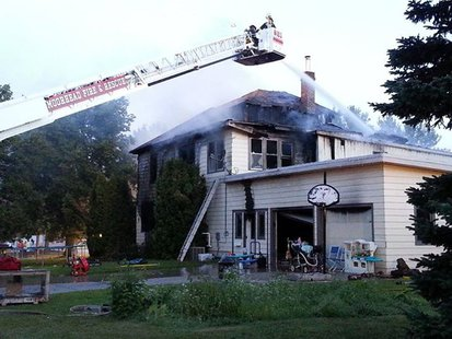 Firefighters still on the scene of a house fire in Hawley, Minn.
