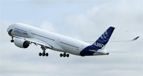 The new Airbus A350 takes off for its maiden flight at the Toulouse-Blagnac airport in southwestern France June 14, 2013. REUTERS/Jean-Phili