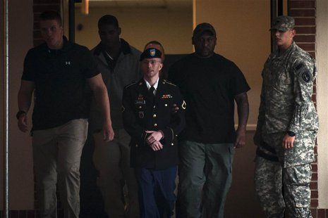 Private First Class Bradley Manning, 25, is escorted out of court after the second day of deliberation in his military trial at Fort Meade,