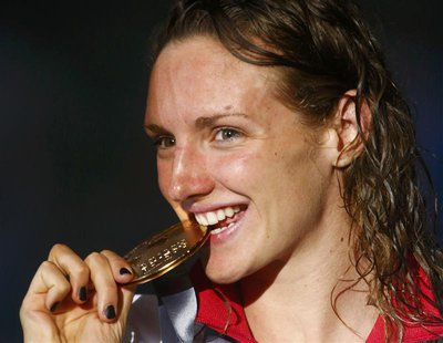 Hungary's Katinka Hosszu bites her gold medal at the women's 200m individual medley victory ceremony during the World Swimming Championships