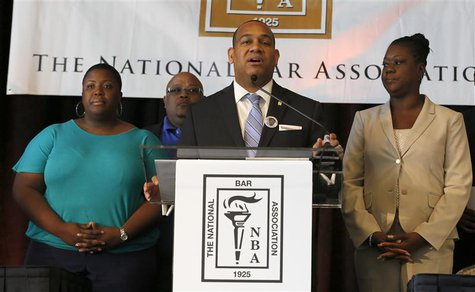 Sybrina Fulton (R) mother of Trayvon Martin, stands with National Bar Association President John Page (C) and Nathaniel and Cleopatra Pendle