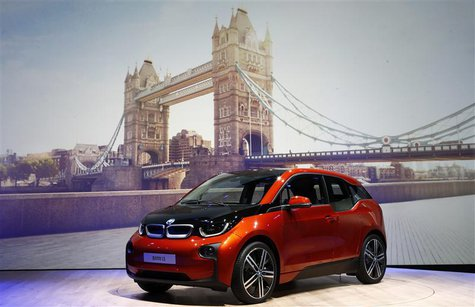 The new BMW i3 electric car is unveiled in front of a projected image of Tower Bridge at a ceremony in London, July 29, 2013. REUTERS/Andrew