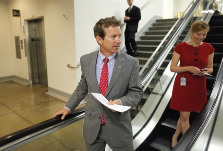 U.S. Senator Rand Paul (R-KY) (L) departs following the weekly Republican caucus luncheon at the U.S. Capitol in Washington June 18, 2013. R