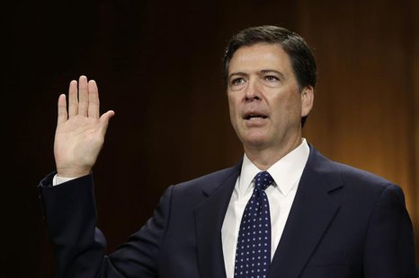 FBI director nominee James Comey is sworn in before testifying at the Senate Judiciary Committee on Capitol Hill in Washington July 9, 2013.
